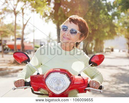 Beautiful Elderly Woman On Motorbike
