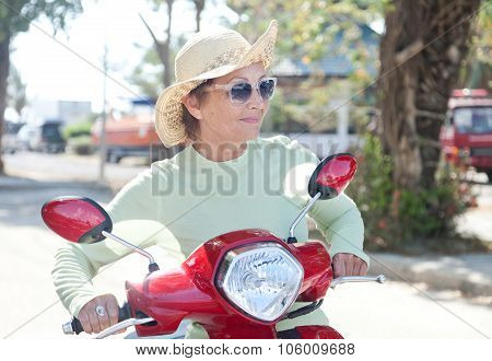 Beautiful Elderly Woman On Motorbike