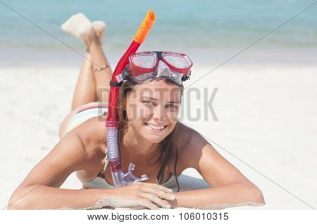 Woman With A Mask For Snorkeling Lying On The Sand Near The Sea