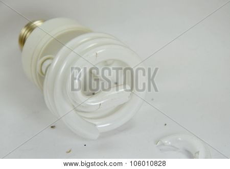 broken fluorescent lamp on white background