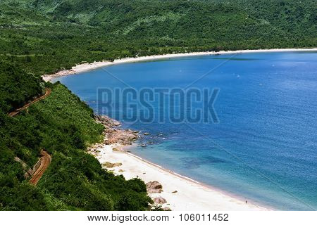 Lonely Blue Ocean Beach Near The Road