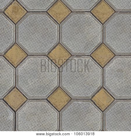 Tiles Laid out of Large Gray Polygons and Small Yellow Squares in the Corners.