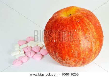 medicine and apple
