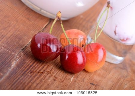 A Delicious Cherry Milkshake On Wooden Plate