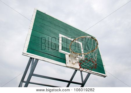 Basketball Hoop  - Outdoor basketball hoop and green backboard, taken from a Bottom side view. Isola