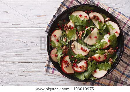 Salad With Apples, Pomegranates, Walnut And Arugula. Horizontal Top View