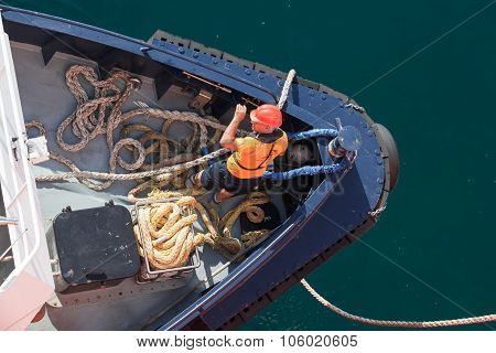 Mooring Operations, Man At Work With Ropes