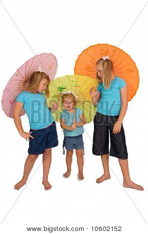 three young pretty girls playing with colorful umbrellas in studio