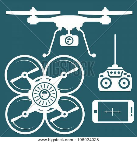 Silhouette of quadcopter and remote contro and smartphone