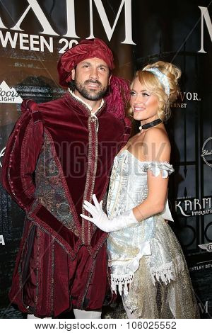 LOS ANGELES - OCT 24:  Maksim Chmerkovskiy, Peta Murgatroyd at the MAXIM Magazine's Official Halloween Party at the Private Estate on October 24, 2015 in Beverly Hills, CA