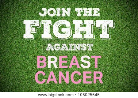 Breast cancer awareness message against close up view of astro turf