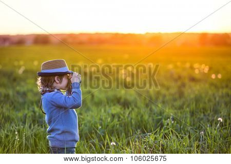 Photographer with camera in the field