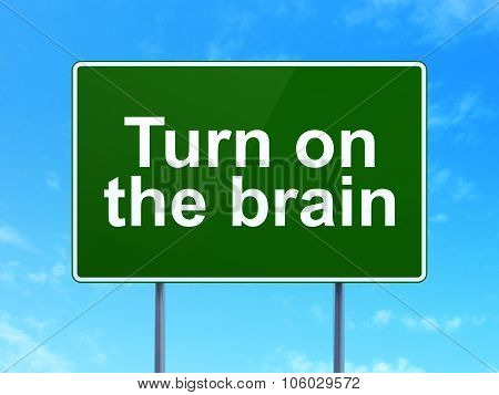 Learning concept: Turn On The Brain on road sign background