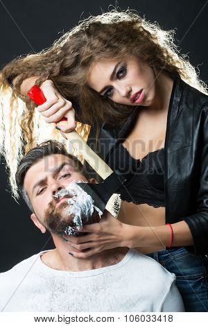 Woman Shaving Handsome Bearded Man