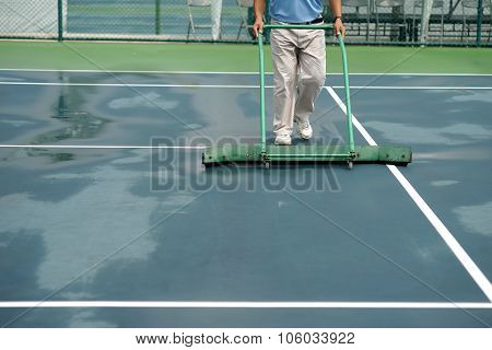 Cleaning Crew Drying Tennis Court After Rain