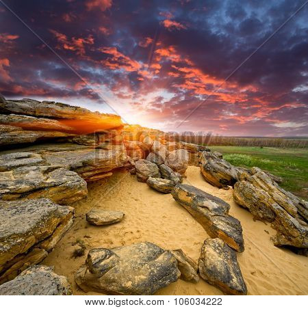 Landscape with stones desert on sunset background