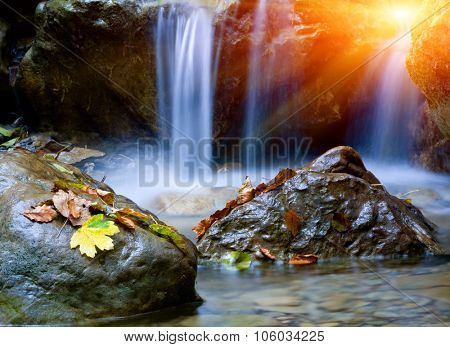 Nice small waterfall in autumn time