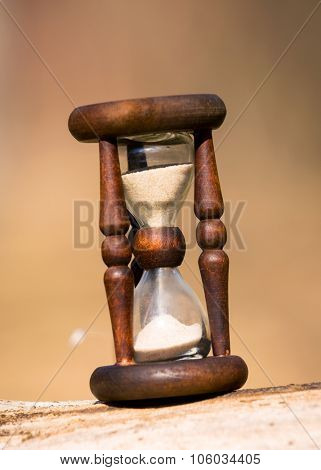 abstract hourglass on wooden surface - soft photo