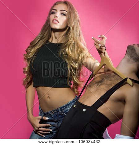 Girl Holds Hangers With Boy