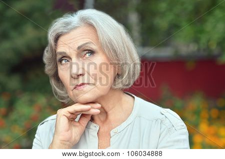 senior woman in summer park