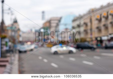 Blurred police car on the street at night. Blur city background