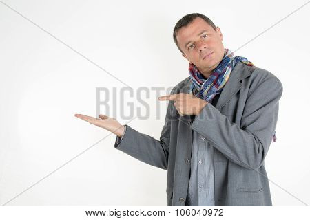 Businessman Pointing Copy Space. Handsome  Man  Looking At Camera And Pointing Away While Standing A