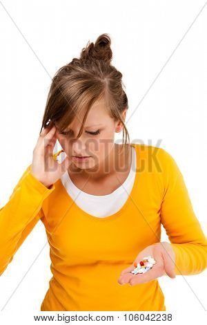 Sore throat - woman holding pills isolated on white background