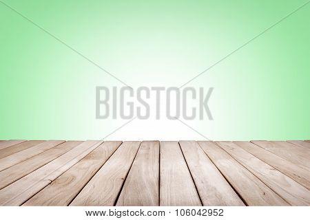 Wooden platform with green background.