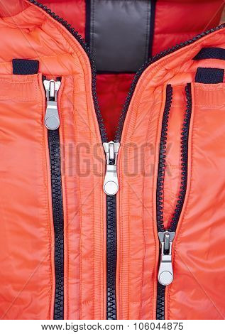 Detail Of Orange Jacket With Zipper