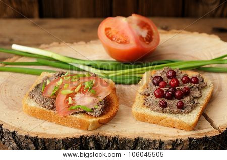 Homemade Pate On Toasts With Tomatoes, Scallion And Cranberries On Saw Cut Wood