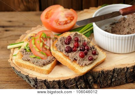 Homemade Liver Pate On Toasts With Fresh Tomatoes, Scallion And Cranberries On Wooden Board
