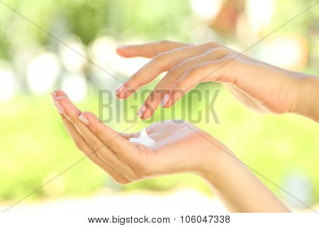 Drop of hand cream on female's hand