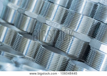Threaded fasteners deposited in layers as a base