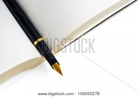 Ink pen on open book