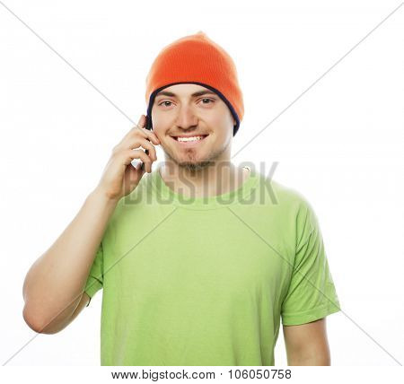 life style, tehnology and people concept: cheerful man in shirt speaking on the phone, isolated on white