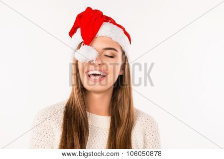 Cheerful Pretty Girl Has Closed Her Eye By Santa's Hat Pompon