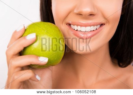 Beautiful Healthy Smile. Girl Smiling With Green Apple