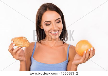 Cute Girl Chooses Between A Healthy Food And Harmful Food
