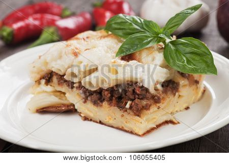 Pasticcio or pastitsio with ground beef and bechamel sauce, italian baked pasta