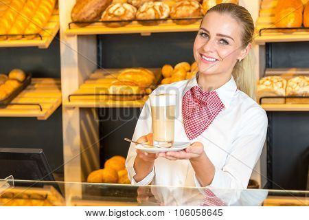 Shopkeeper At Bakery Or Baker's Shop Presenting Coffee