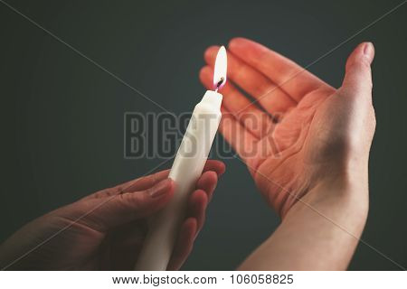 Female Hands With Burning Candle In The Dark