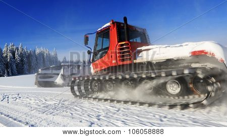 Groomer In Motion On A Snowy Meadow