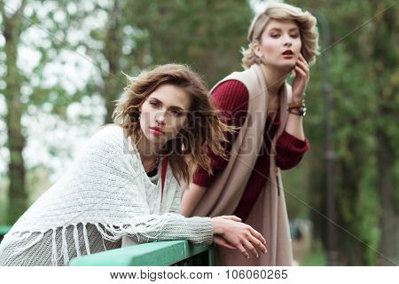 Autumn. Photo of a two beautiful women in the park.
