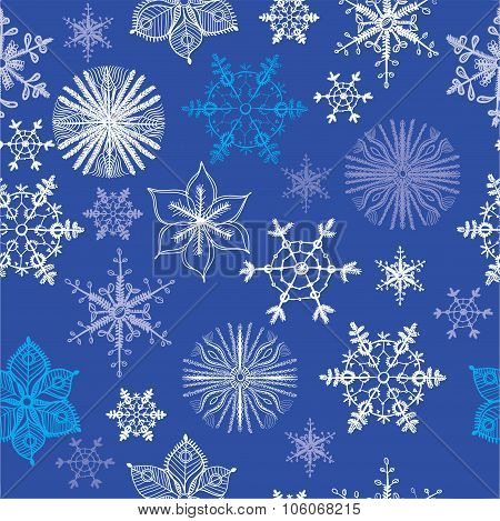 Seamless pattern of different hand drawn snowflakes