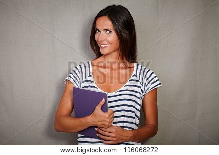 Charismatic Youngster Smiling While Holding Tablet