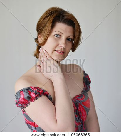 Portrait of a woman in  dress with bare shoulders