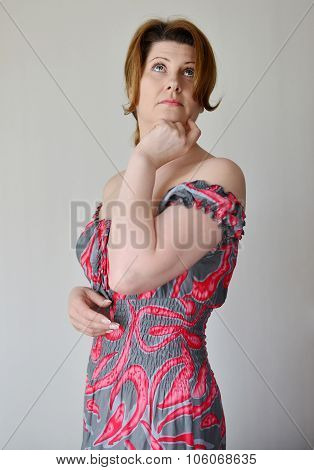 Portrait of  woman in a dress with bare shoulders