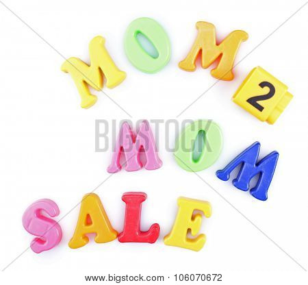 Concept of childish goods sale - magnetic plastic letters isolated on white background