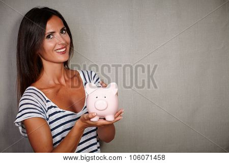 Good-looking Brunette Lady Holding A Moneybox