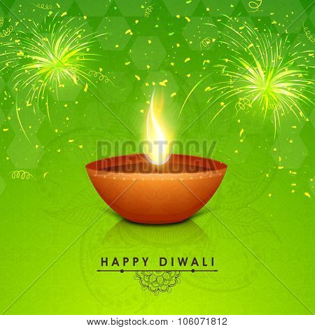 Traditional illuminated oil lit lamp on floral decorated shiny fireworks background for Indian Festival of Lights, Happy Diwali celebration.